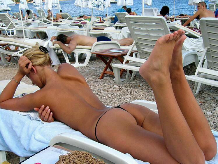 Tanning her nice butt