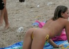 Hot topless blonde bending over in a barely there bikini