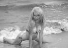 Flirty girl posing playfully in the sea