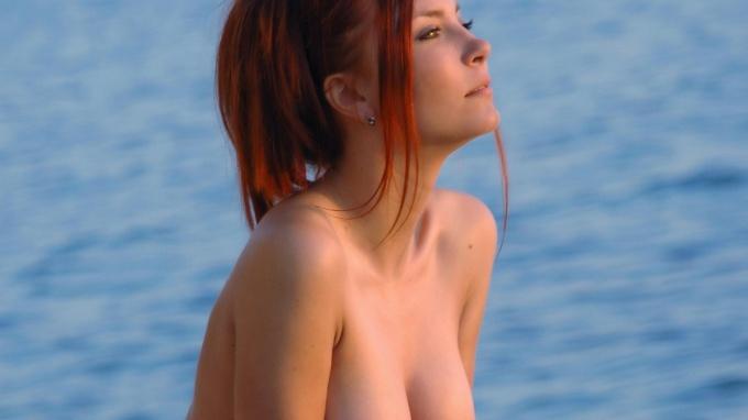 Redhead cutie near the sea