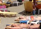 Sweet topless girls catching the sun