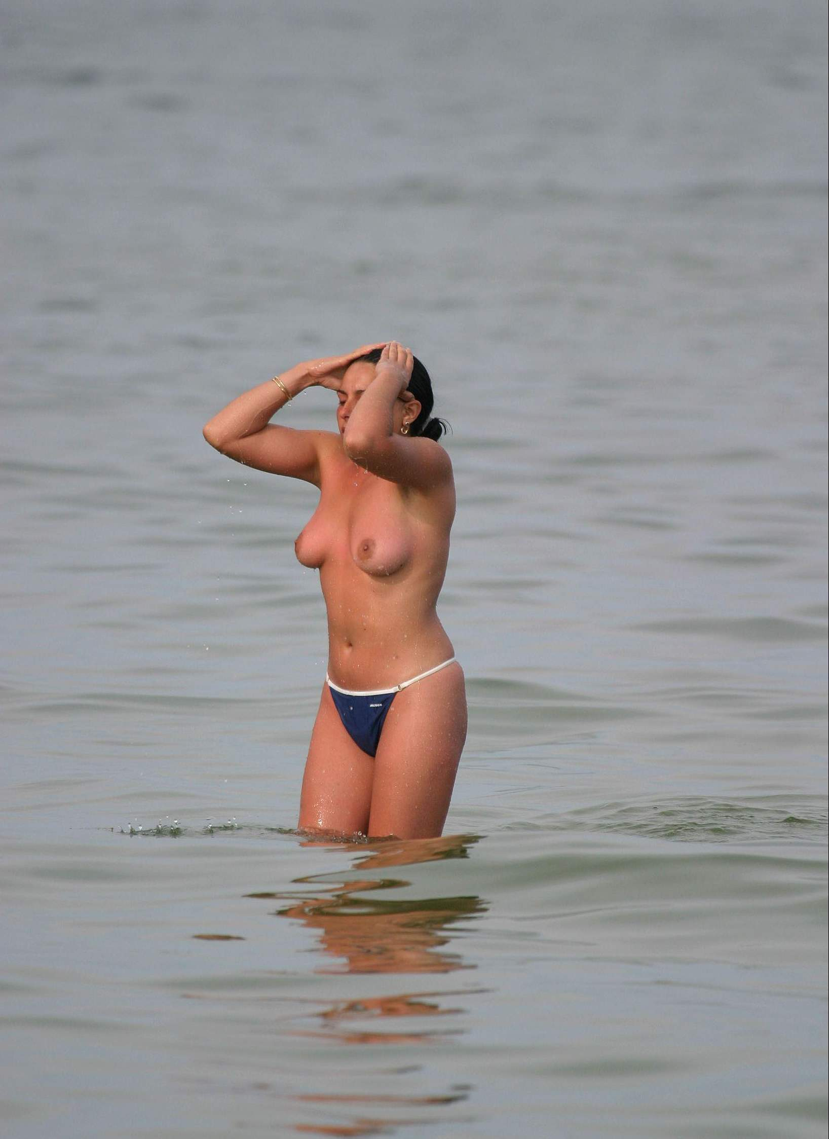 Topless beauty wet and horny